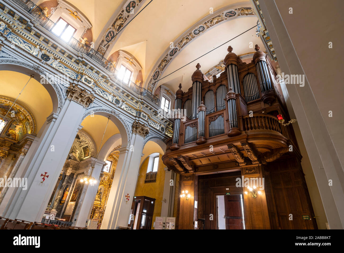 The large wooden pipe organ in the Cathedral Sainte Reparate in the Old Town section of Nice, France, on the French Riviera. Stock Photo