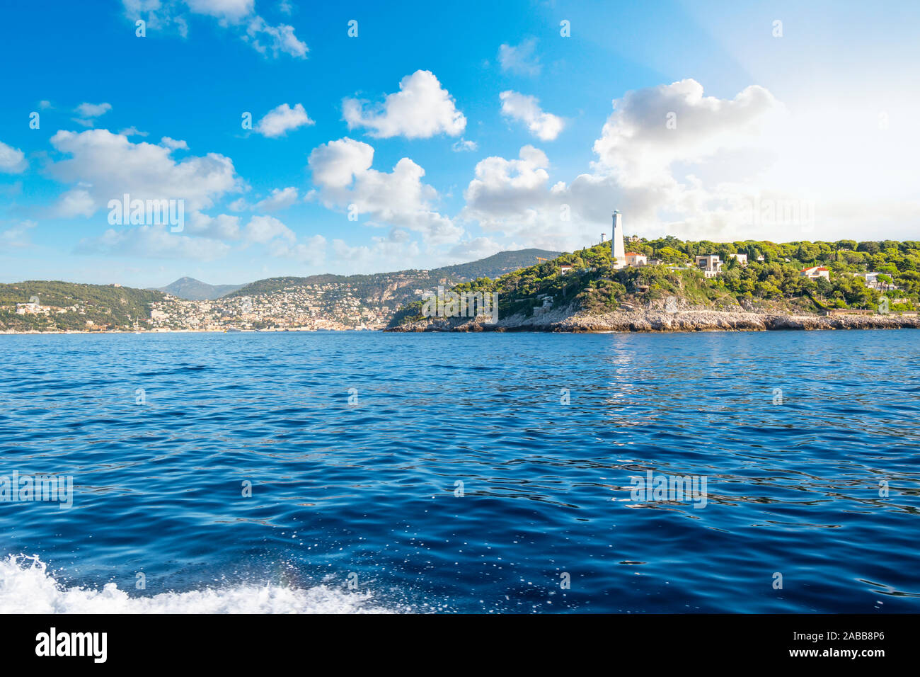 View from the Mediterranean Sea of the Saint Jean Cap Ferrat lighthouse on the Southern coast of France and the French Riviera. Stock Photo