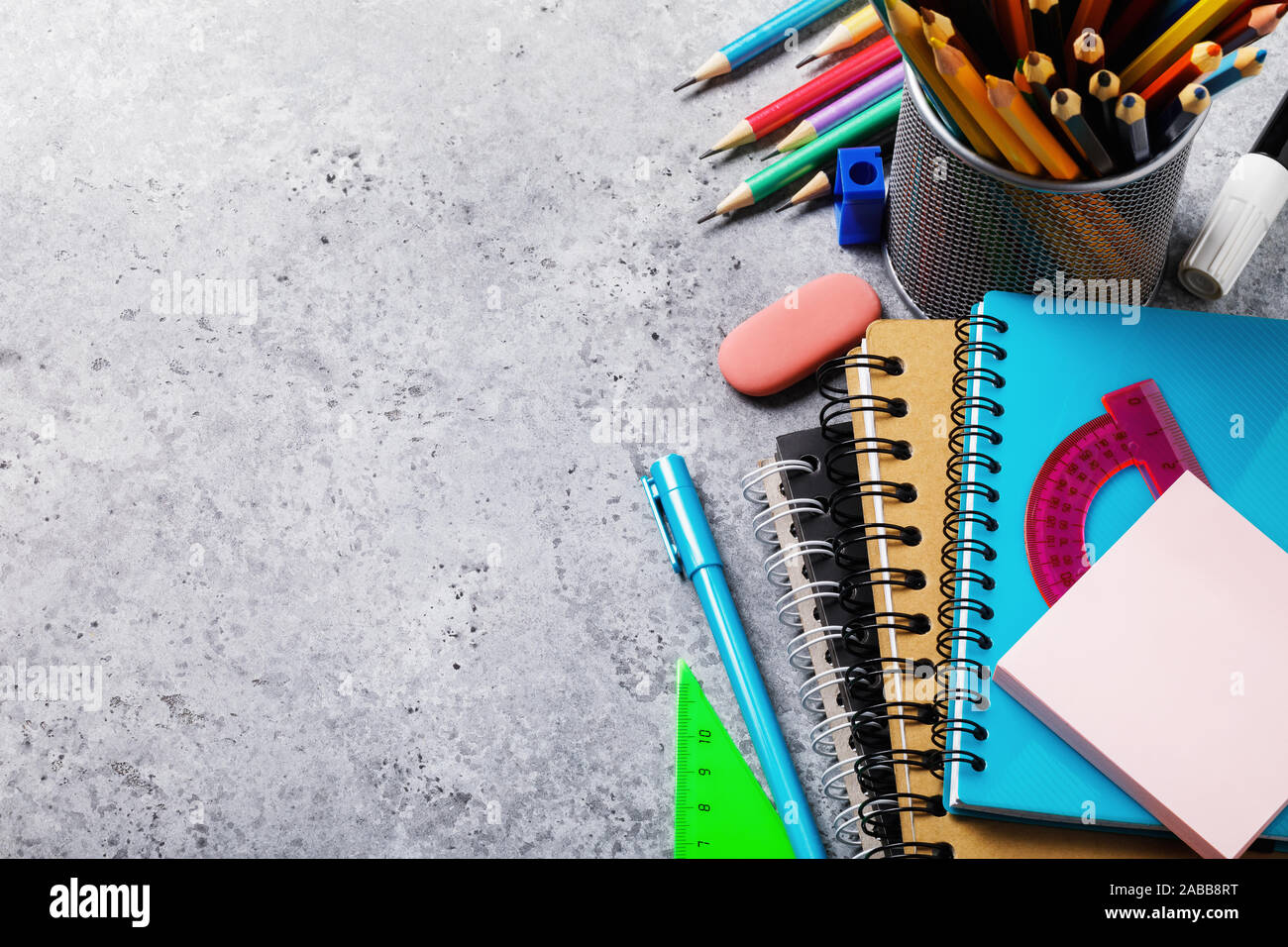 Different supplies for schoolchildren and students on the table with copy space. Top view on pencils, notebooks and rulers Stock Photo