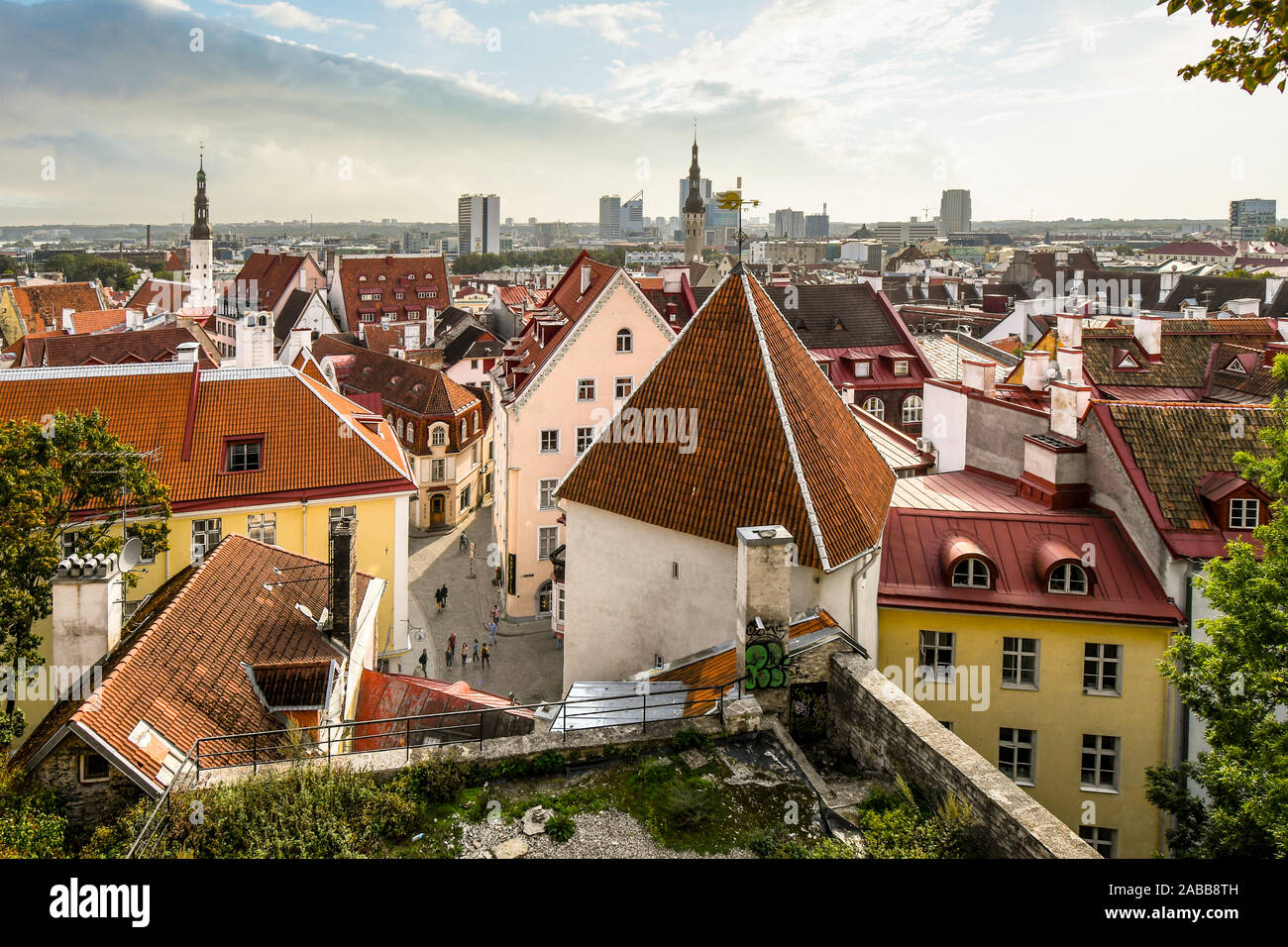View of the medieval streets and rooftops of lower old town Tallinn, Estonia from upper town Toompea Hill on an overcast morning in late summer. Stock Photo