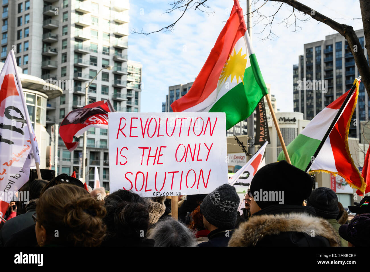 Torontonians gather at Mel Lastman Square to show support for the protesters in Iran on November 23, 2019 while Kurdish and Shir o Khorshid flags wave Stock Photo