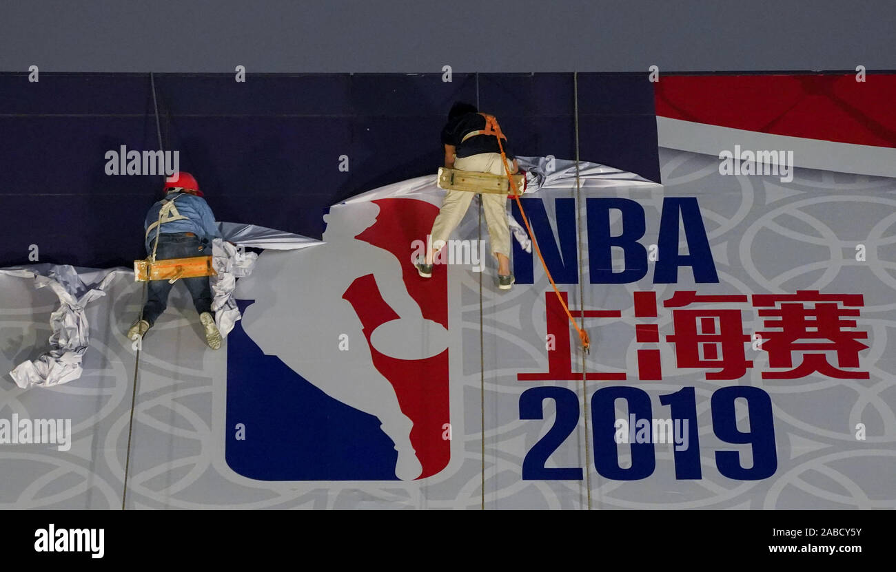 Construction workers dismentle a giant poster of NBA before 2019 NBA Shanghai in Lujiazui, Shanghai, China, 9 October 2019. Stock Photo