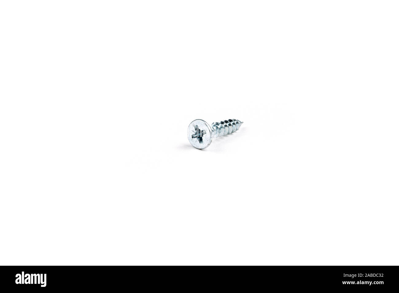 Metal screw for wood on white background. Isolate Stock Photo