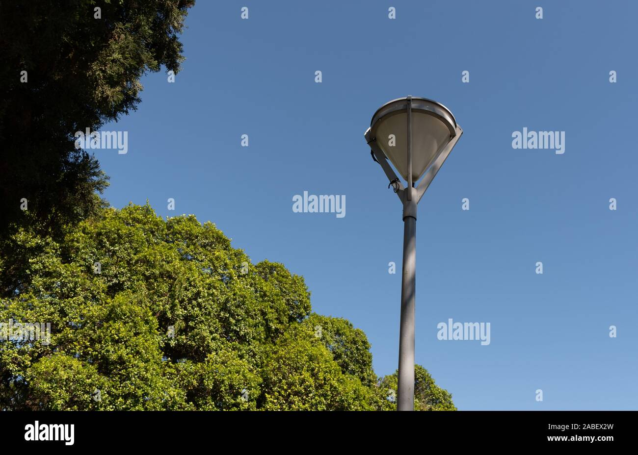 An old light fixture component of the public lighting of a square in southern Brazil. Lighting artifact and electric power. Old object. Stock Photo