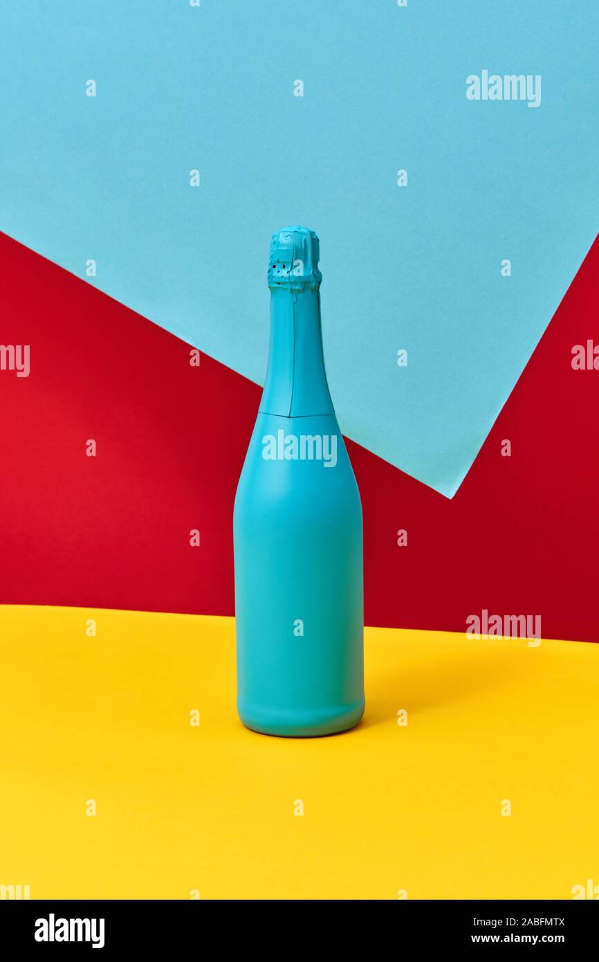 Creative Blue Painted Holiday Wine Bottle Mock Up On A Tricolor Blue Red Yellow Background With Copy Space Minimalism Concept Stock Photo Alamy