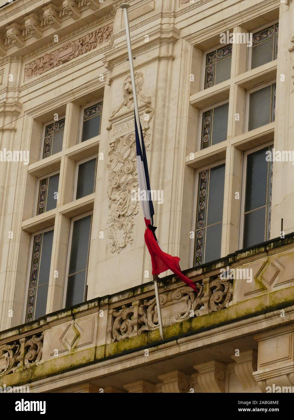 Tribute to the 13 French soldiers of Operation Barkhane Killed in Mali monday, November 25, 2019,The French  Flag of  City Hall of Niort at  half mast Stock Photo