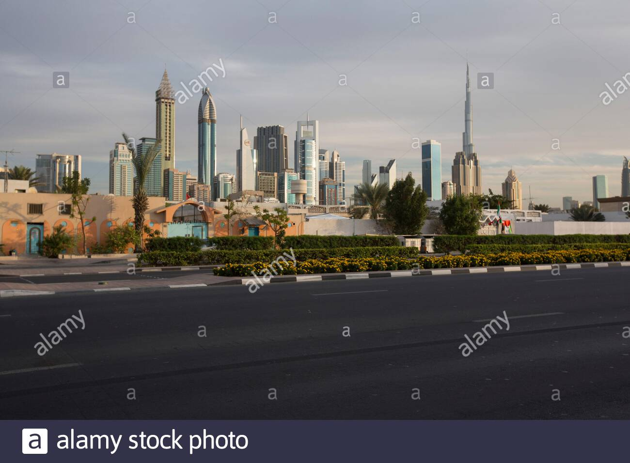 United Arab Emirates - Dubai - A view over Sheikh Zayed Road from Satwa, an old neighborhood of Dubai. Sheikh Zayed Road is the main artery of the city.The highway runs parallel to the coastline from Trade Centre Roundabout to the border with the emirate of Abu Dhabi, 55 kilometres (34 mi) away in the area of Jebel Ali.(LF)The Sheikh Zayed Road is home to most of Dubai's skyscrapers, including the Emirates Towers. The highway also connects other new developments such as the Palm Jumeirah and Dubai Marina. Stock Photo