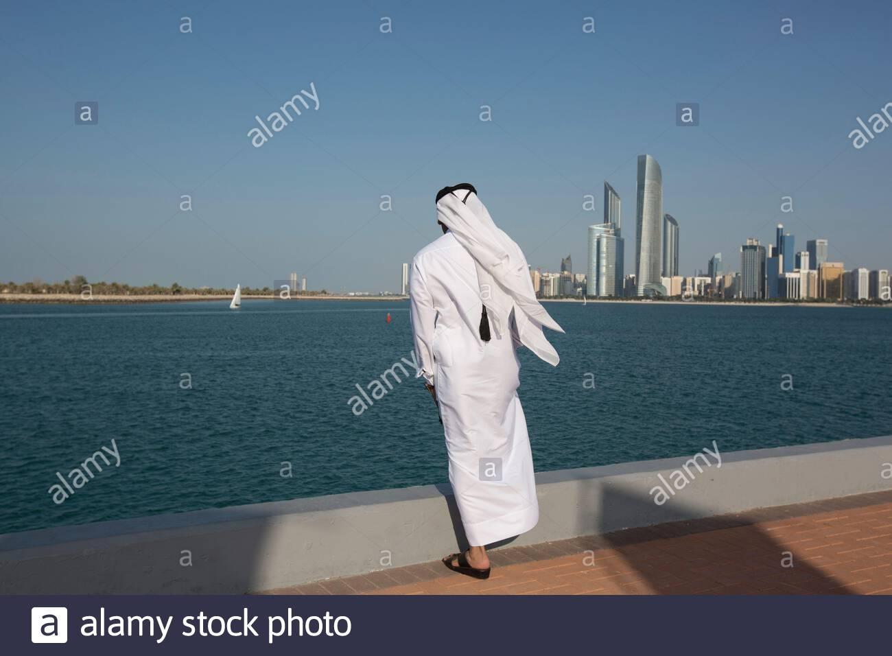 United Arab Emirates - Abu Dhabi - A Emirati man looking towards Business District. Stock Photo