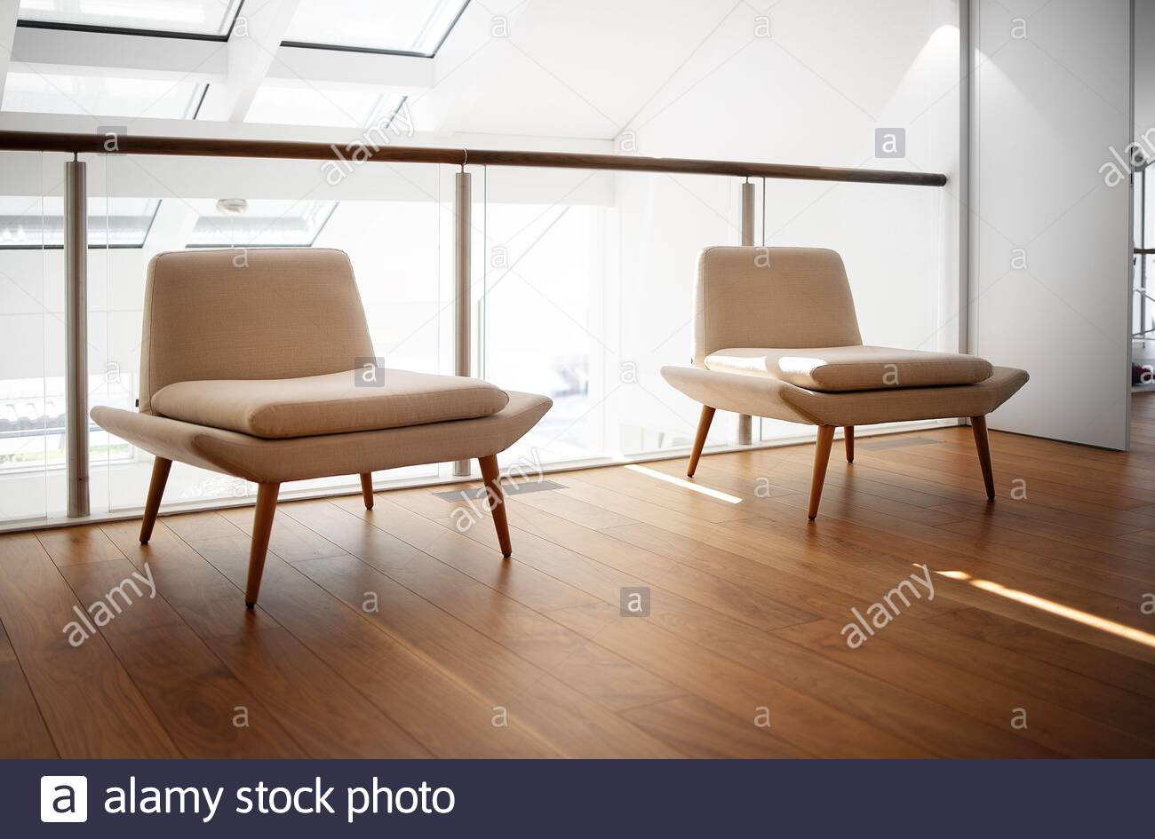 Modern minimalistic interior. Living room with two armchairs ...