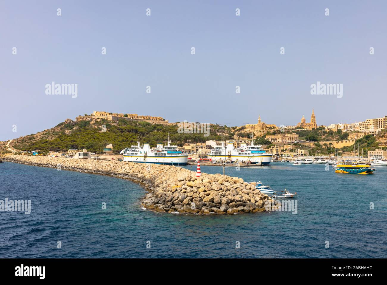Panorama view of Gozo island of Malta from the Mgarr habor on a sunny day Stock Photo