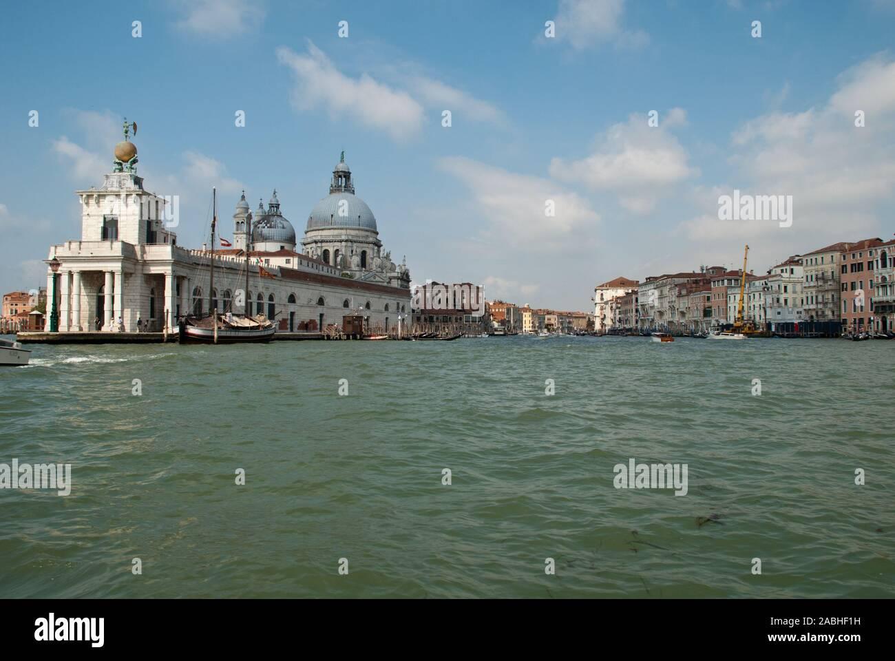 Venice, Italy: Basilica di Santa Maria della Salute und Punta della Dogana, view from a boat into the Grand Canal Stock Photo