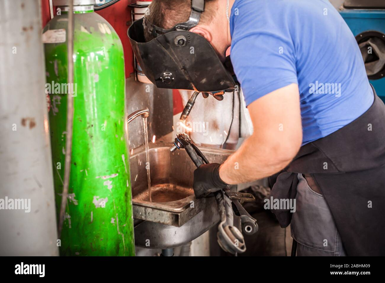 Auto Mechanic Working With Welding Mask Cooking Metal On Automatic Welding Machine For Repairing Cardan Shafts In Service Workshop Sparks Flying In T Stock Photo Alamy