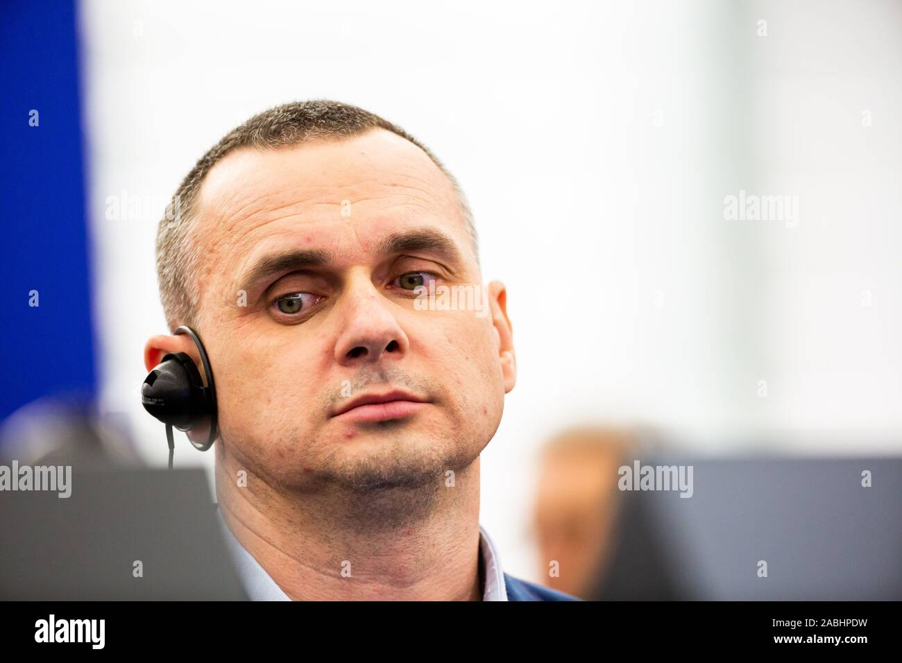 26 November 2019, France (France), Straßburg: The Ukrainian film director and former political prisoner Oleg Senzow (l-r) sits in the plenary hall of the European Parliament during the laudation by the President of the European Parliament, Sassoli, on the occasion of the award of the Sakharov Prize for Freedom of Thought to Senzow. Senzow was imprisoned in Russia from May 2014 to September 2019. Photo: Philipp von Ditfurth/dpa Stock Photo