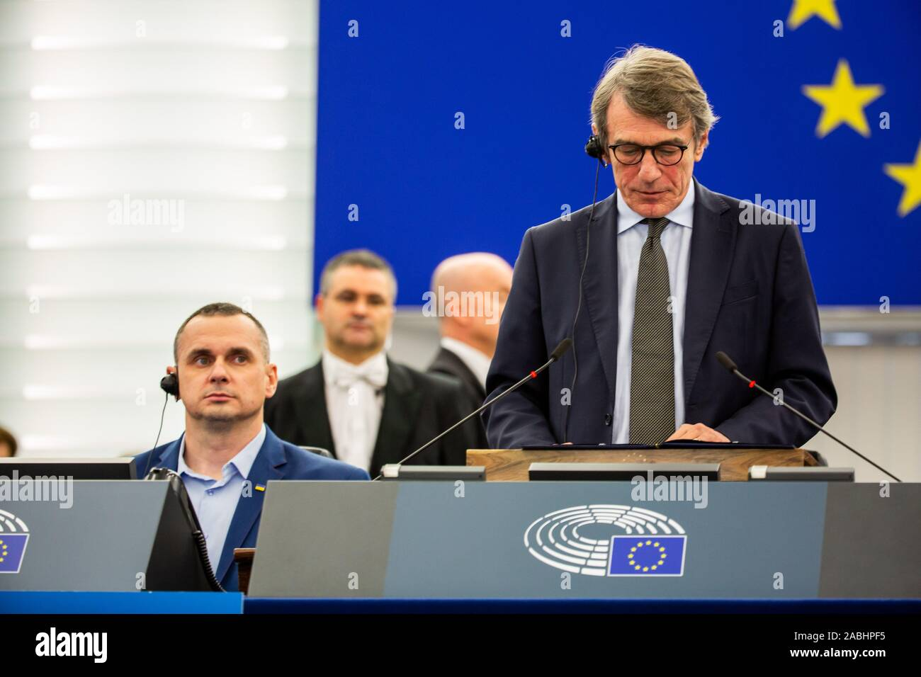 26 November 2019, France (France), Straßburg: The Ukrainian film director and former political prisoner Oleg Senzow (l-r) sits in the plenary hall of the European Parliament during the laudation by the President of the European Parliament David Sassoli on the occasion of the award of the Sakharov Prize for Freedom of Thought to Senzow. Senzow was imprisoned in Russia from May 2014 to September 2019. Photo: Philipp von Ditfurth/dpa Stock Photo