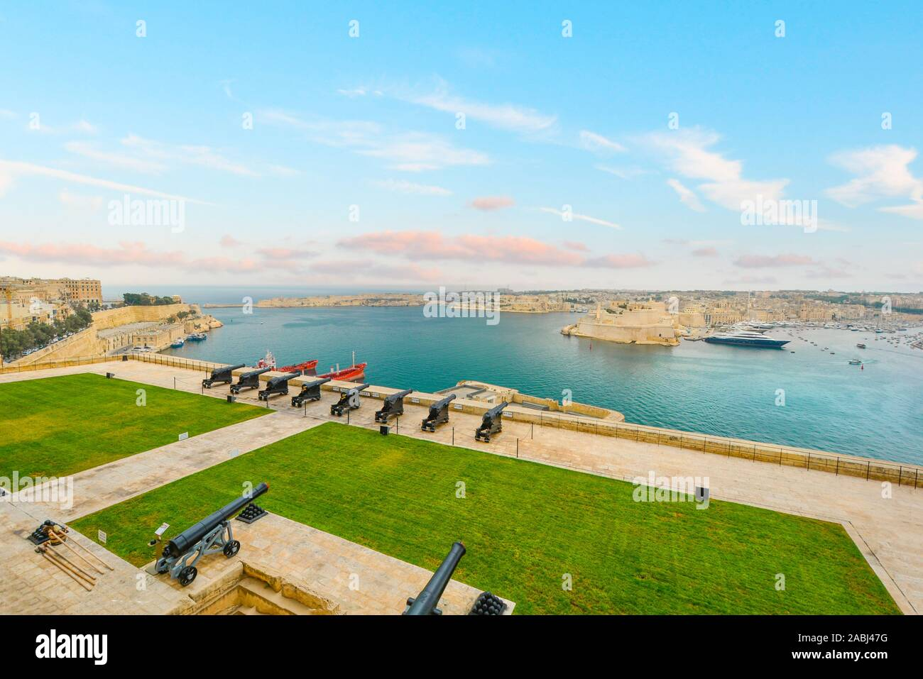 Saluting battery cannons guarding the harbor and city of Valletta on the mediterranean island of Malta Stock Photo