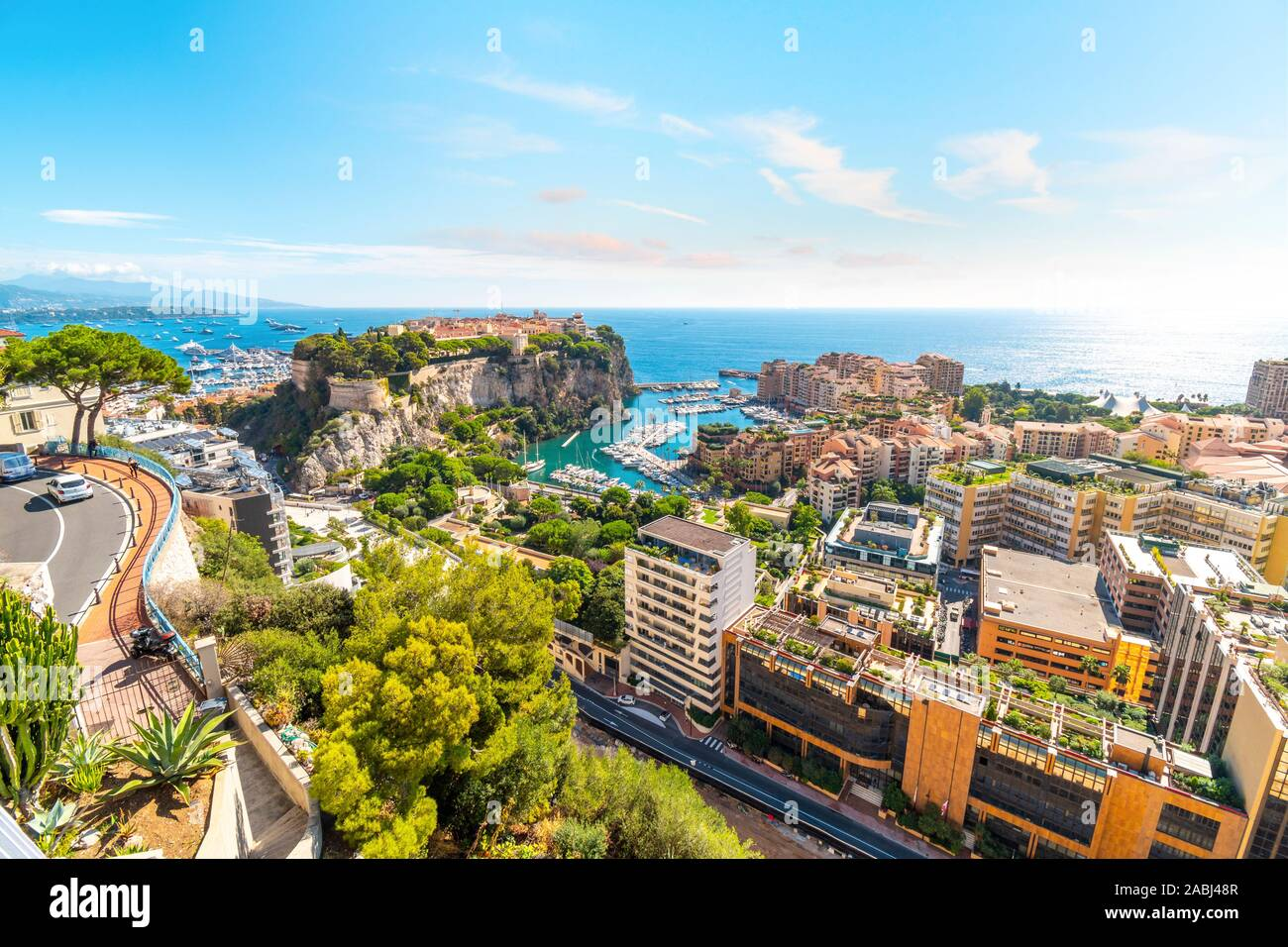 View of the Mediterranean Sea, and the marina, port, cities of Monte Carlo and Fontvieille, and rock of Monte Carlo, Monaco, from the Exotic Gardens Stock Photo