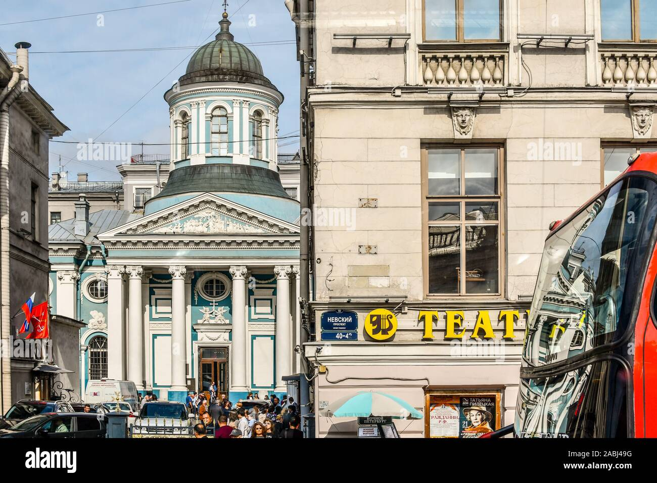 Russian pedestrians pass churches, shops and cafes in the busy downtown section of St. Petersburg, Russia. Stock Photo