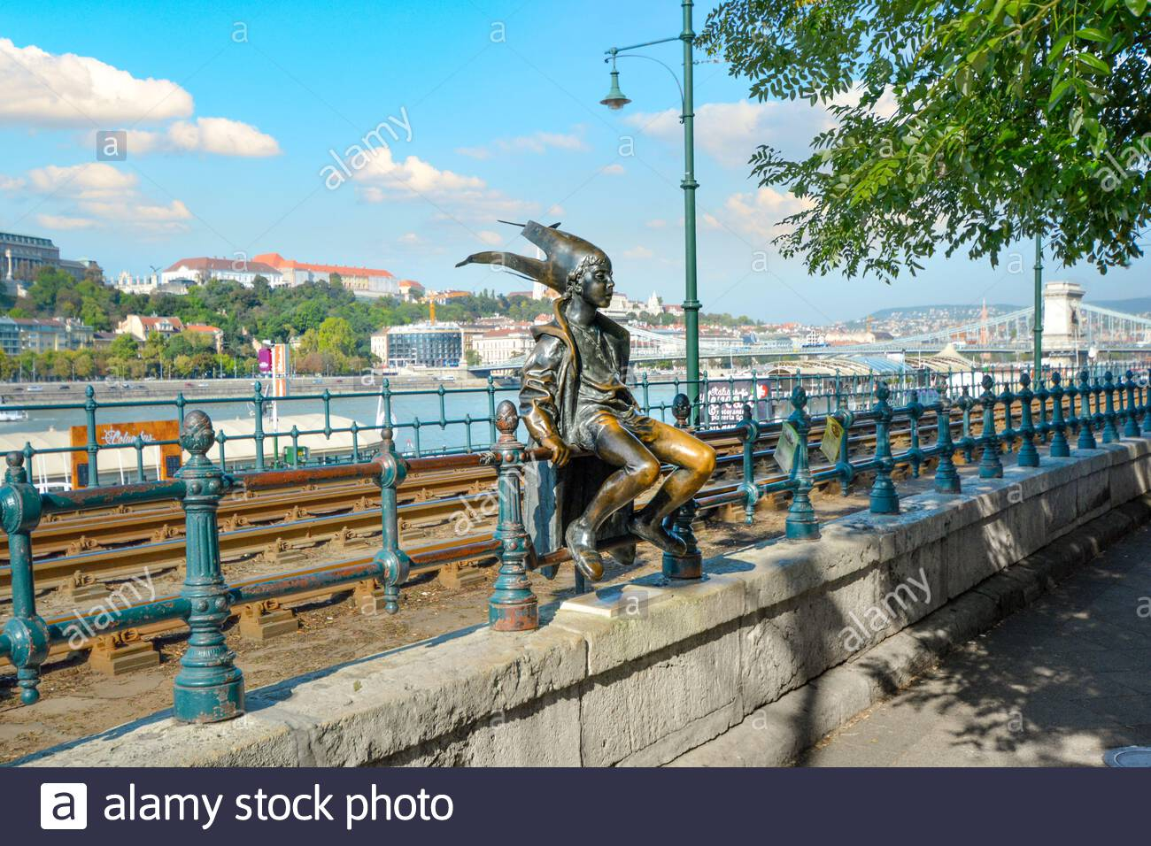 The statue of the Little Princess (Kiskirálylány) sitting on the railings of the Danube promenade in Budapest, Hungary, created by László Marton Stock Photo