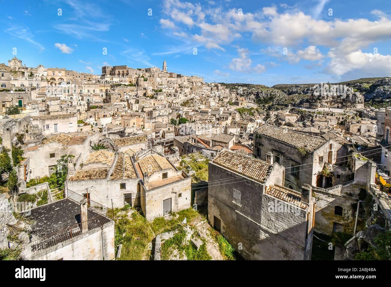 Panoramic shot of the sassi caves, ancient Madonna de Idris rock church, Matera Cathedral and the city of Matera, Italy, in the Basilicata Region. Stock Photo
