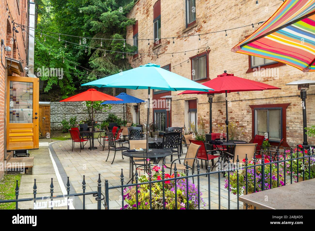 A colorful outdoor patio sidewalk cafe in the historic city of Wallace, Idaho, in the Silver Valley area of North Idaho, USA Stock Photo