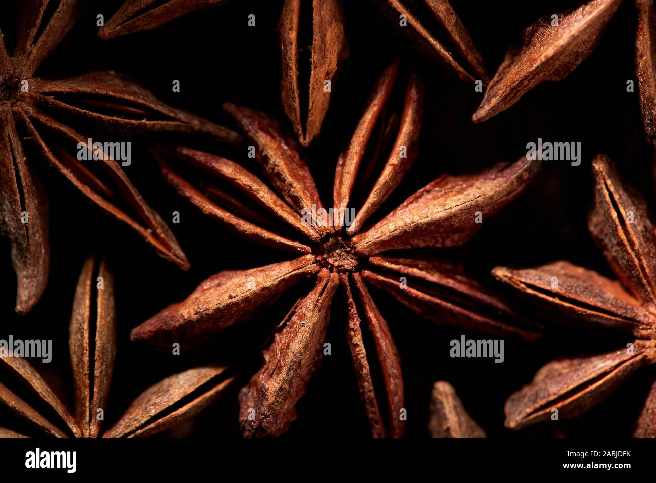 Pattern of Badyan star anise seeds close up at the market in India Stock Photo