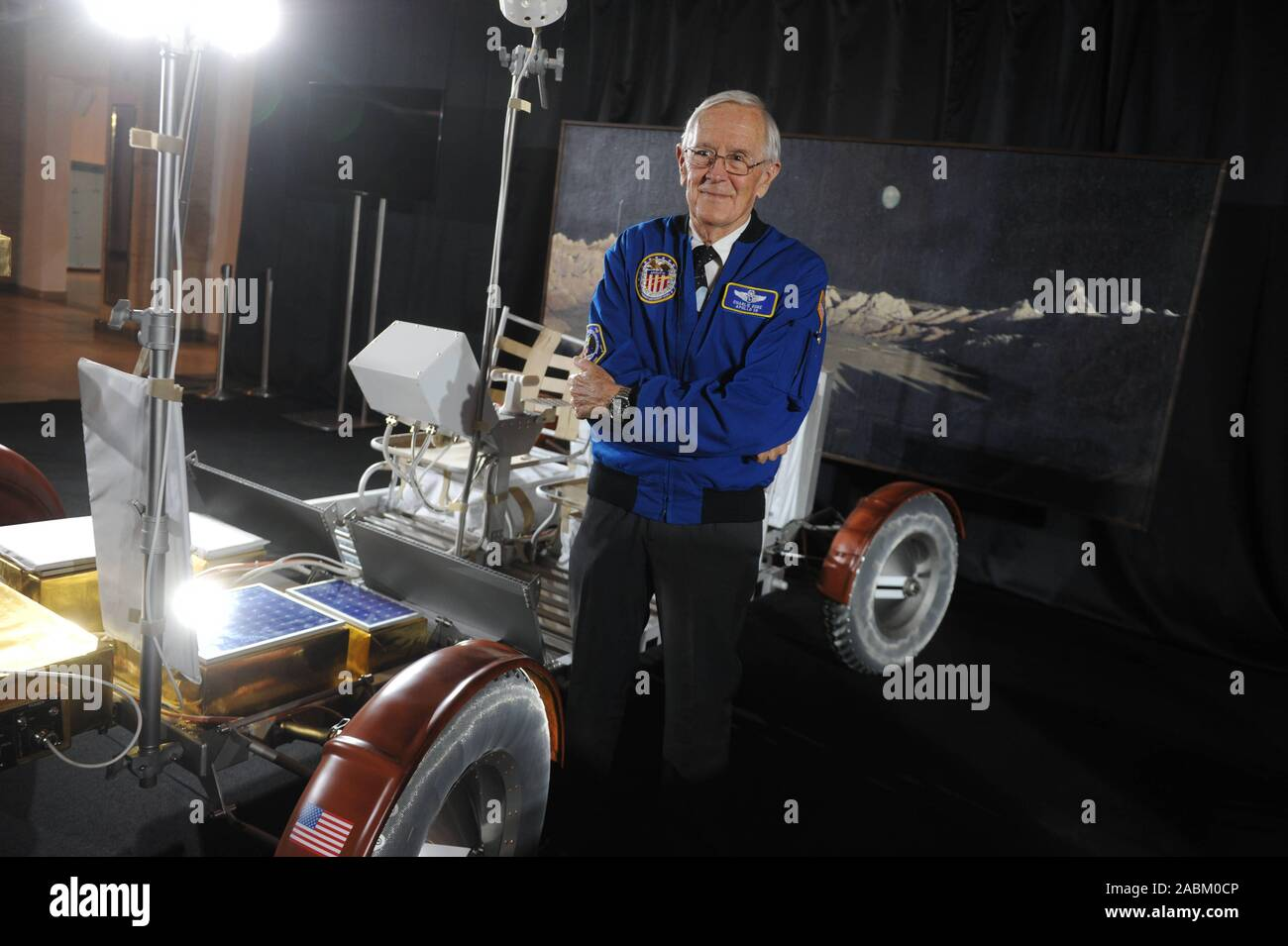 """The US astronaut Charles """"Charlie"""" Moss Duke talks about his experiences in space at the Deutsches Museum. Duke piloted the lunar module of the Apollo 16 mission in 1972 and drove over the moon by car after landing. The picture shows the youngest Moonwalker to date with a replica of a rover. [automated translation] Stock Photo"""