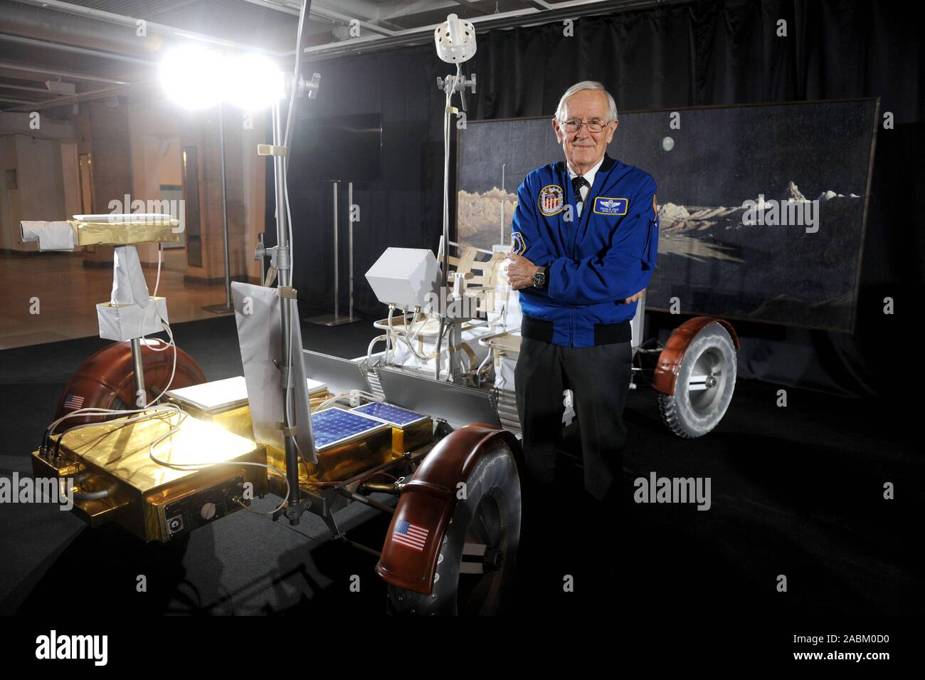 "The US astronaut Charles ""Charlie"" Moss Duke talks about his experiences in space at the Deutsches Museum. Duke piloted the lunar module of the Apollo 16 mission in 1972 and drove over the moon by car after landing. The picture shows the youngest Moonwalker to date with a replica of a rover. [automated translation] Stock Photo"