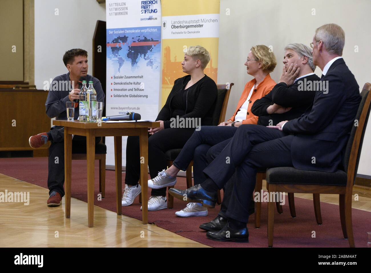 """Discussion event at the Munich City Hall on the topic of """"Right-wing terror and the failure of the state"""" on the first anniversary of the pronouncement of judgement in the NSU proceedings. The picture shows the discussants from the left: Moderator Thies Marsen (Bavarian Broadcasting), Caro Keller (NSU-watch), Annette Ramelsberger (Süddeutsche Zeitung), Mehmet Daimagüler (representative in the NSU trial) and Clemens Binninger (former chairman of the NSU investigative committee in the German Bundestag). [automated translation] Stock Photo"""