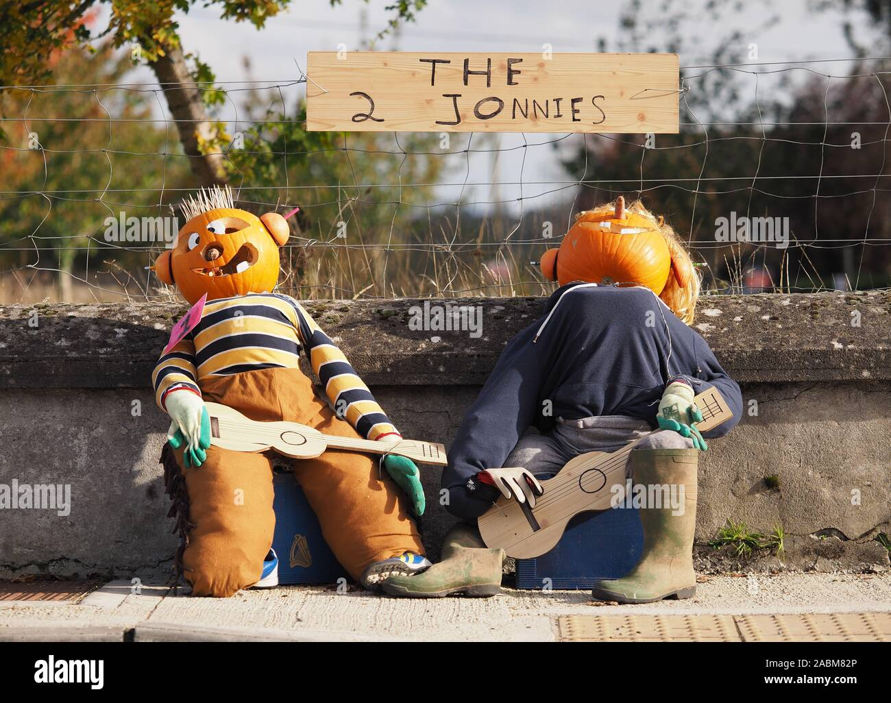 Halloween scarecrows of comedy duo 'The 2 johnnies' in New Inn, Tipperary, Ireland Stock Photo
