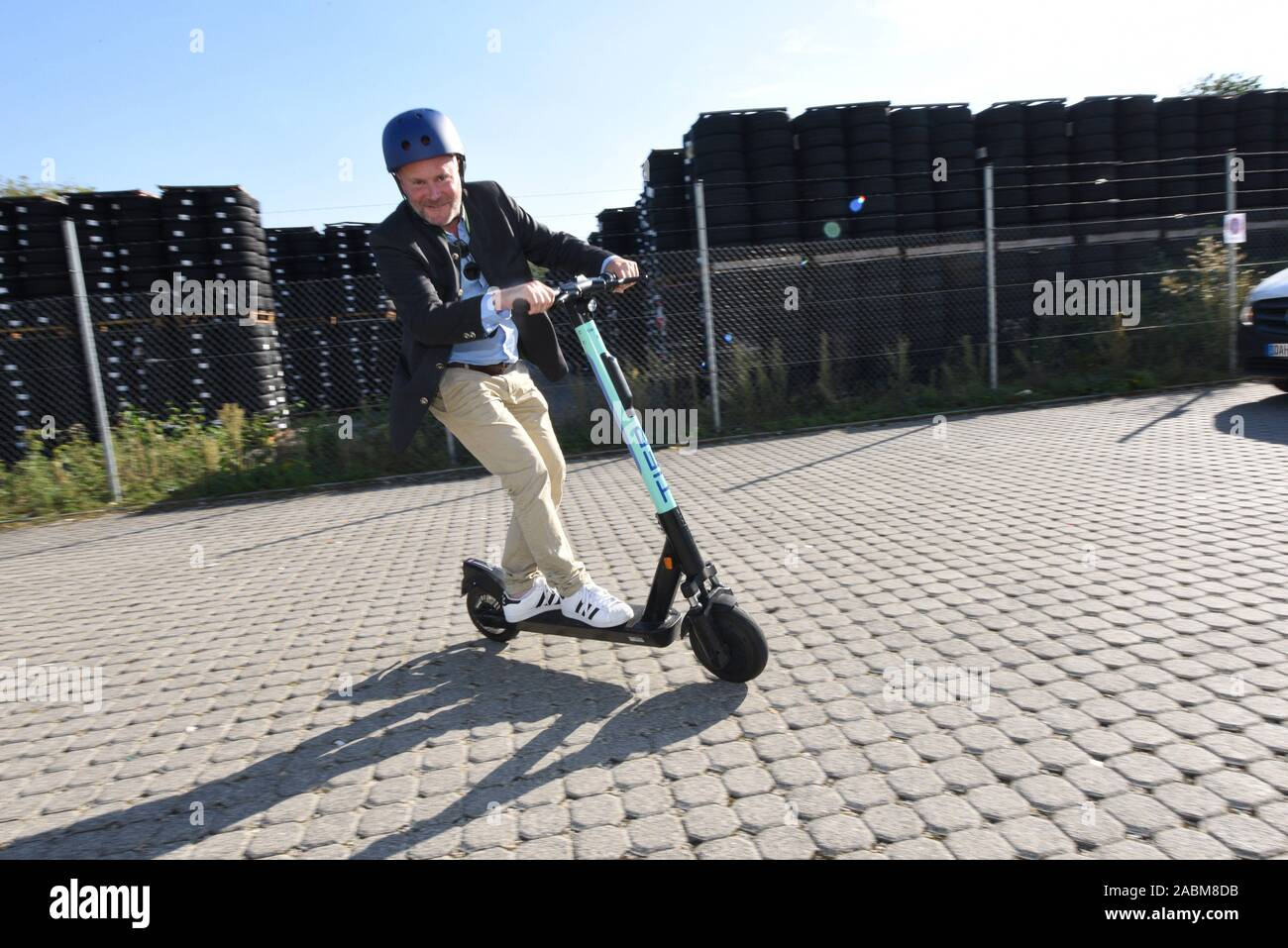 City councillor Christian Vorländer on an electric pedal scooter on TIER's premises in Garching. [automated translation] Stock Photo