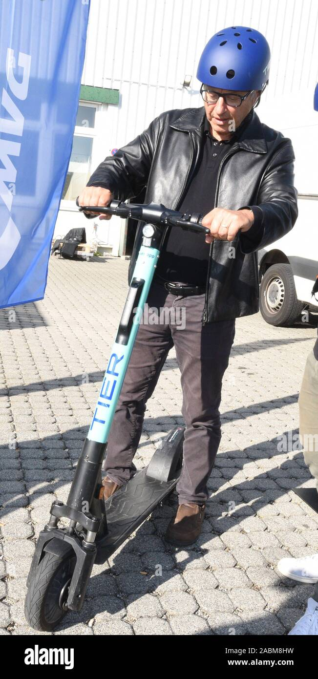 SPD city councillor Marian Offman practices on an electric pedal scooter on the TIER premises in Garching. [automated translation] Stock Photo