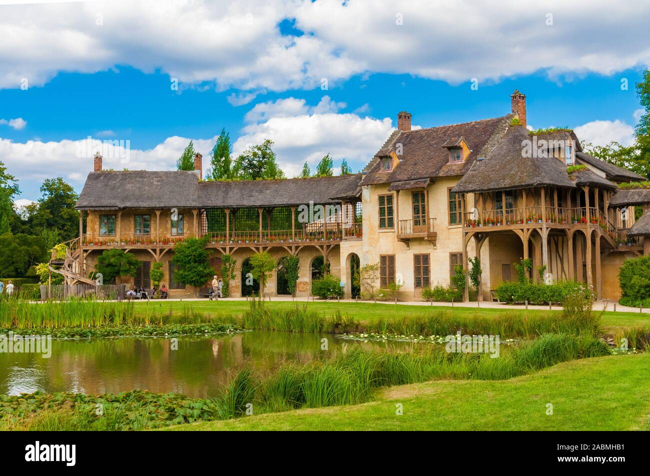 Lovely panoramic view of the Queen's House and the adjoining Réchauffoir in the Hamlet of the Trianon gardens in Versailles. The two rustic buildings... Stock Photo