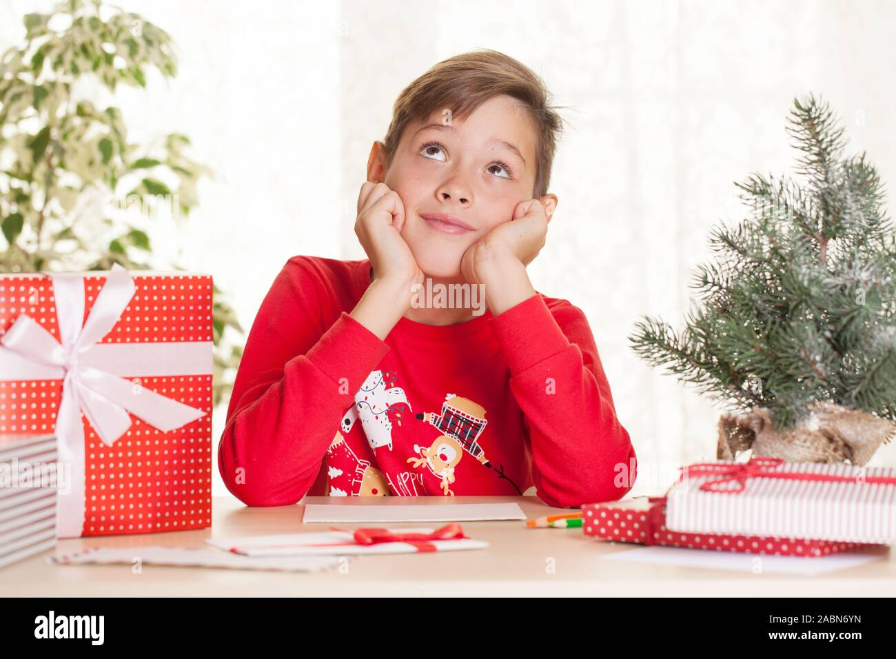 Little Boy Is Going To Write A Letter To Santa Claus About Christmas Gift And Wishes Stock Photo Alamy