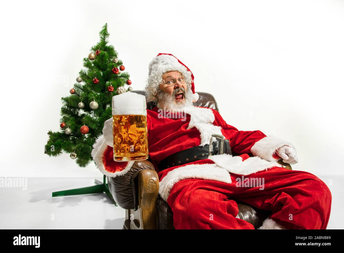 Christmas Beers 2020 Santa Claus drinking beer near the Christmas tree, congratulating