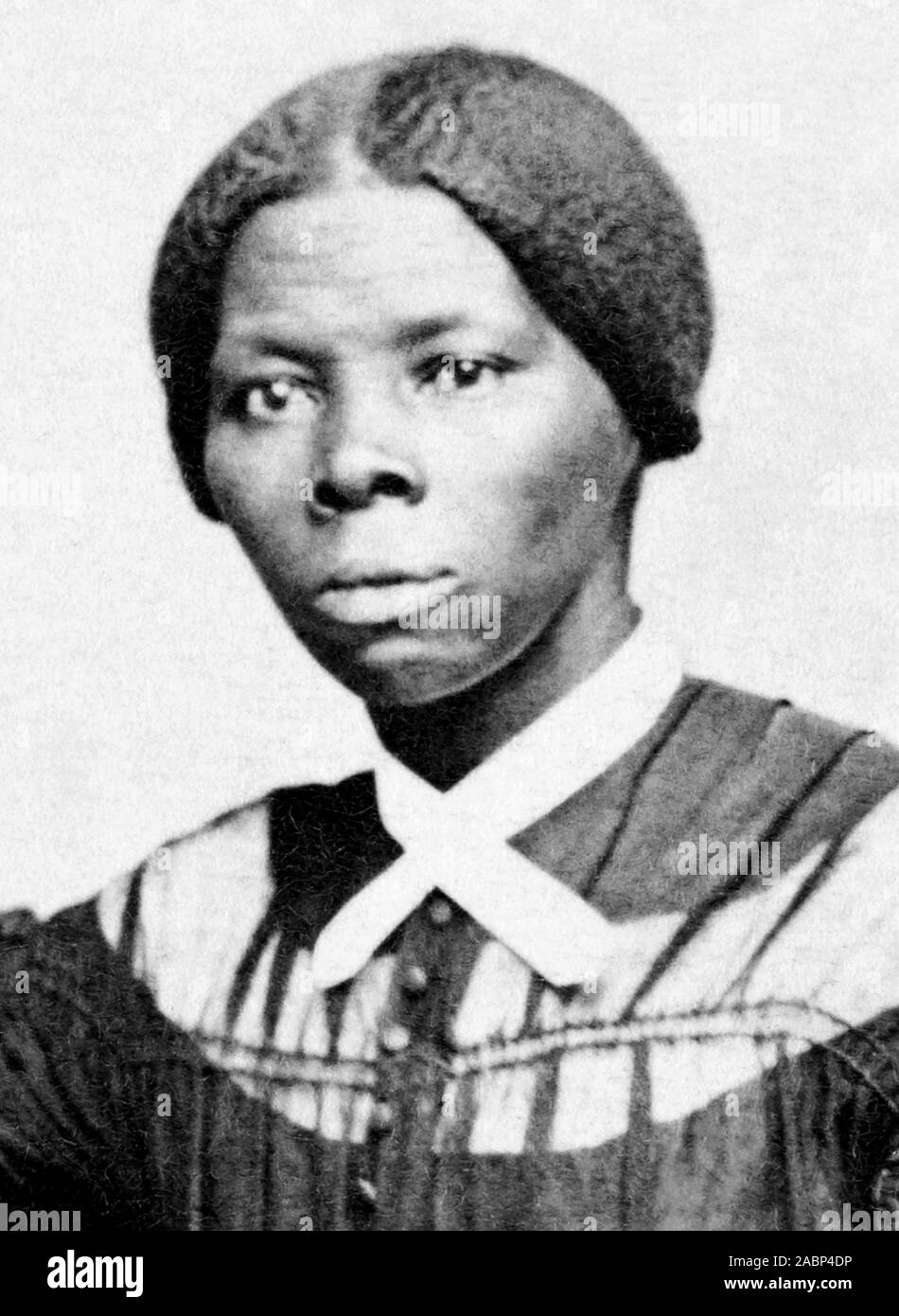 Vintage portrait photo of Harriet Tubman (c1820 – 1913). Born into slavery, Tubman (birth name Araminta Ross) escaped and later guided other slaves to freedom via the Underground Railroad before working as a nurse, spy and scout for the Union Army during the American Civil War. In later life she engaged in humanitarian work and promoted the cause of women's suffrage. Photo circa 1868 by Benjamin F Powelson. Stock Photo