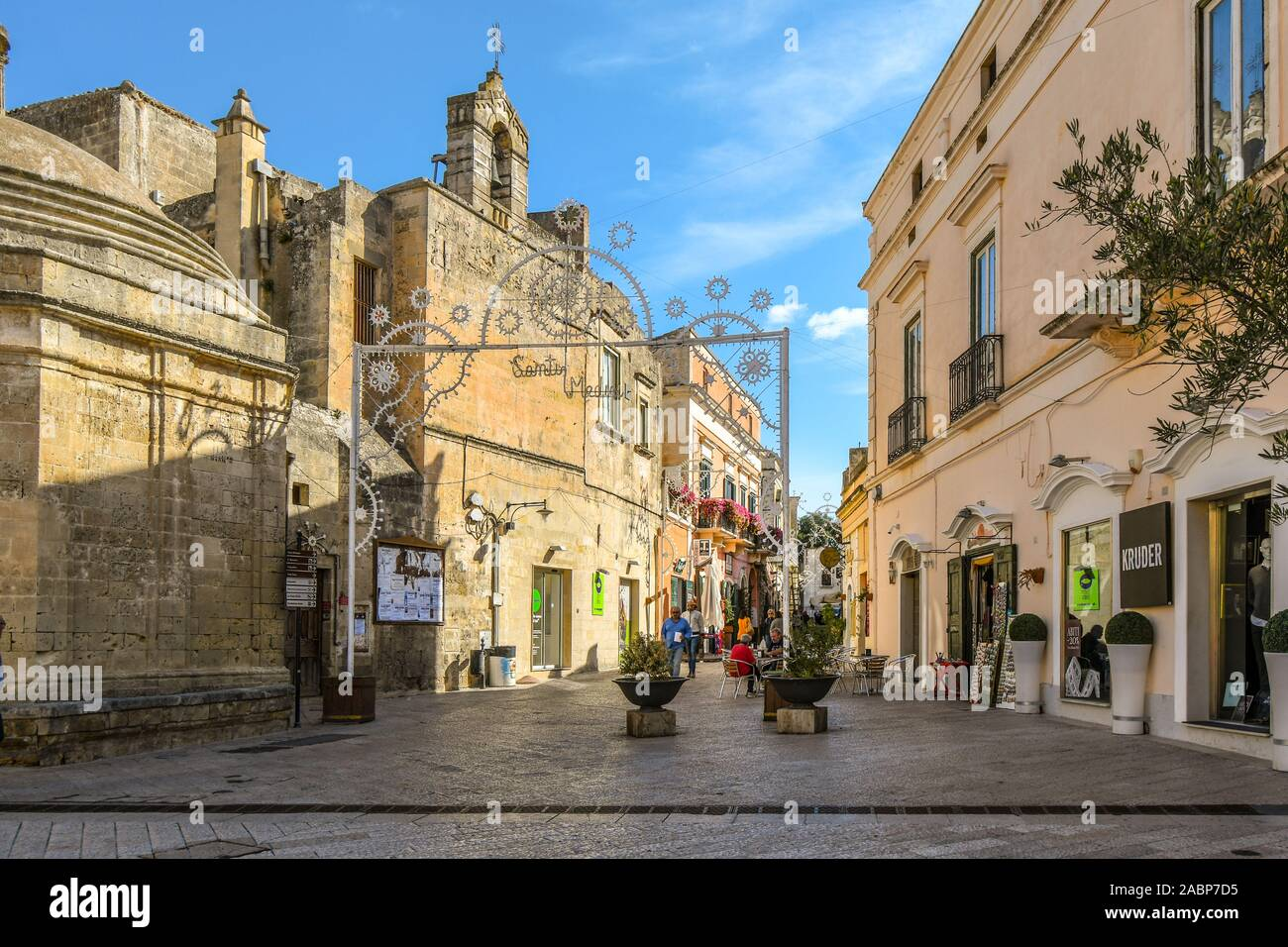 Street decorations adorn Via San Biagio in the town of Matera, Italy as it prepares for the September Santi Medici procession through the ancient city Stock Photo