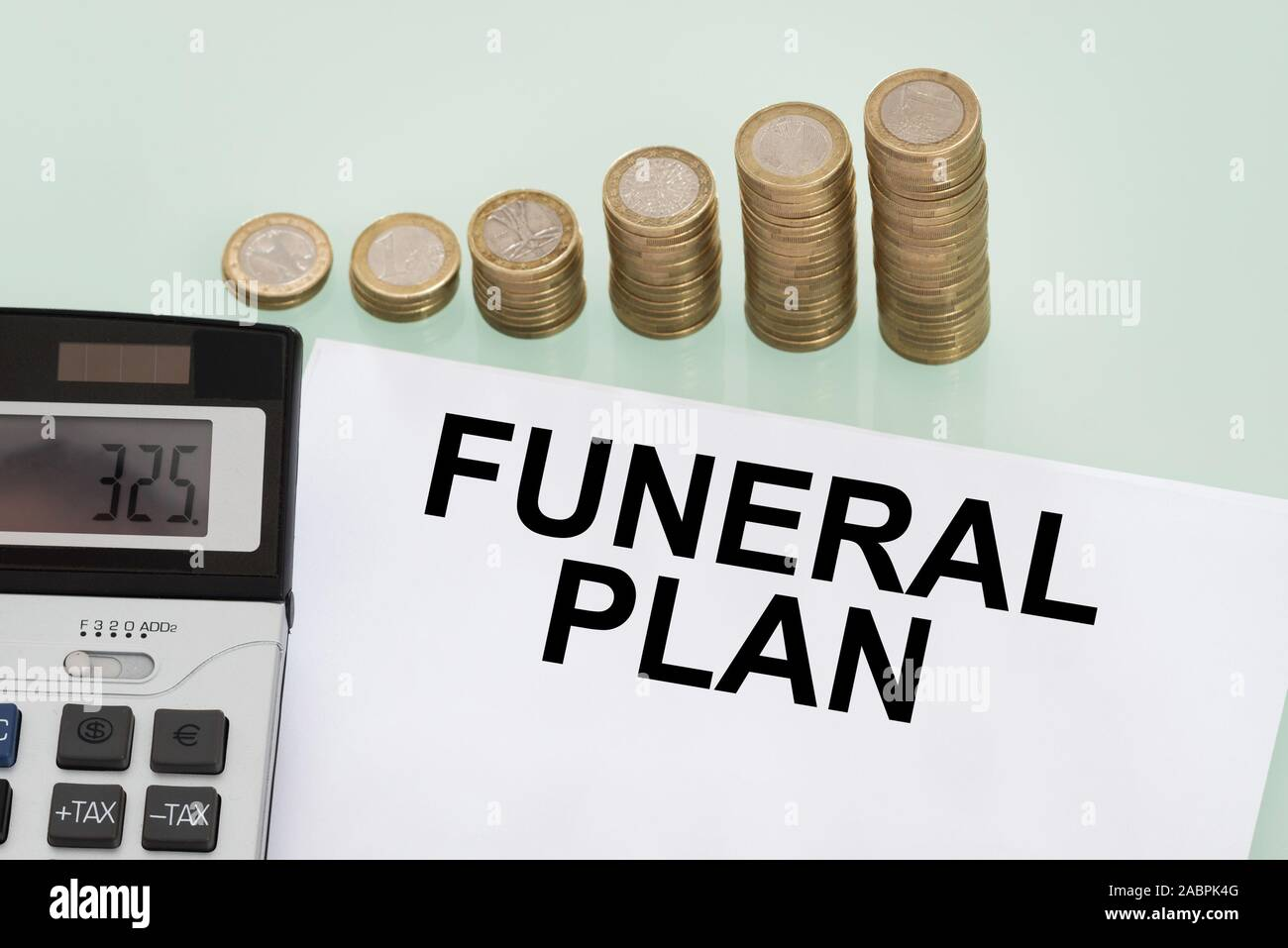 Funeral Plan Papers, Stack Of Coins And Calculator Stock Photo