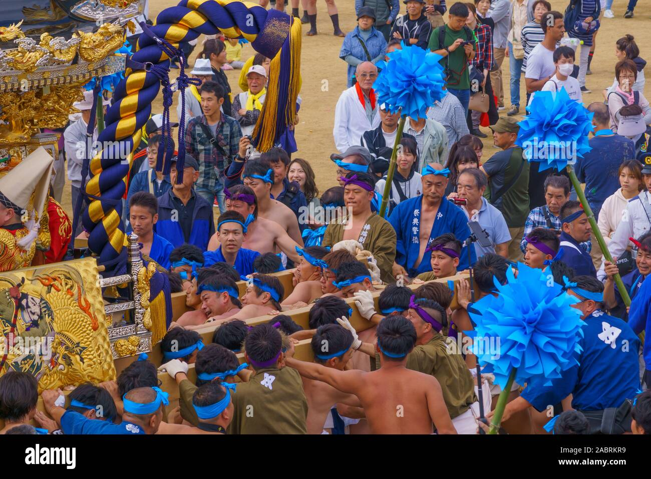 Himeji, Japan - October 15, 2019: Portable shrine carried by men in traditional dressing, and crowd. Part of the Nada no Kenka Festival, in Himeji, Ja Stock Photo