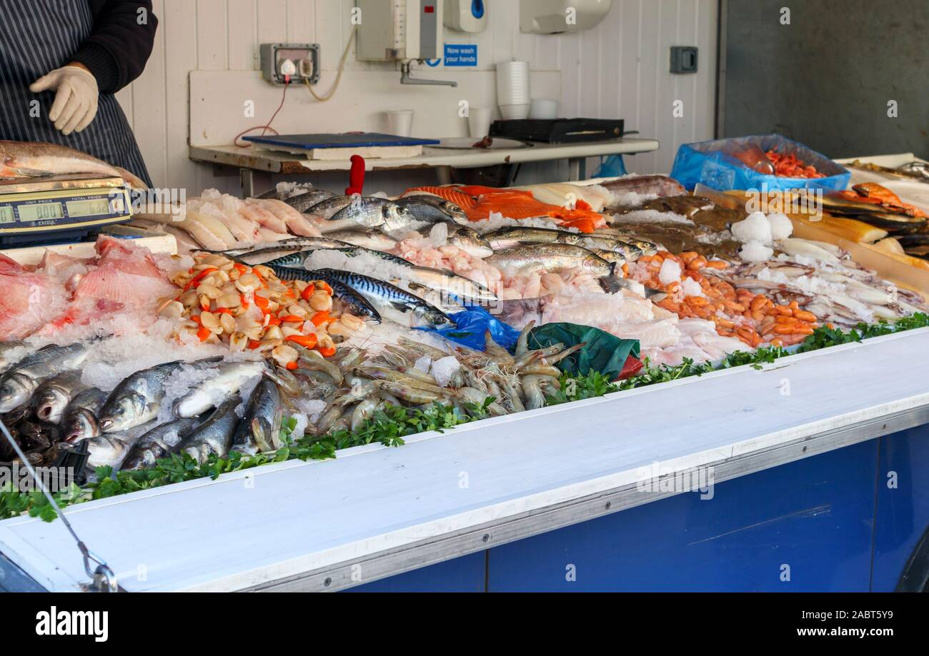 Fishmonger's van stall with a display of fresh fish in Staines-Upon-Thames Market, High Street, Staines, a town in Spelthorne, Surrey, SE England, UK Stock Photo