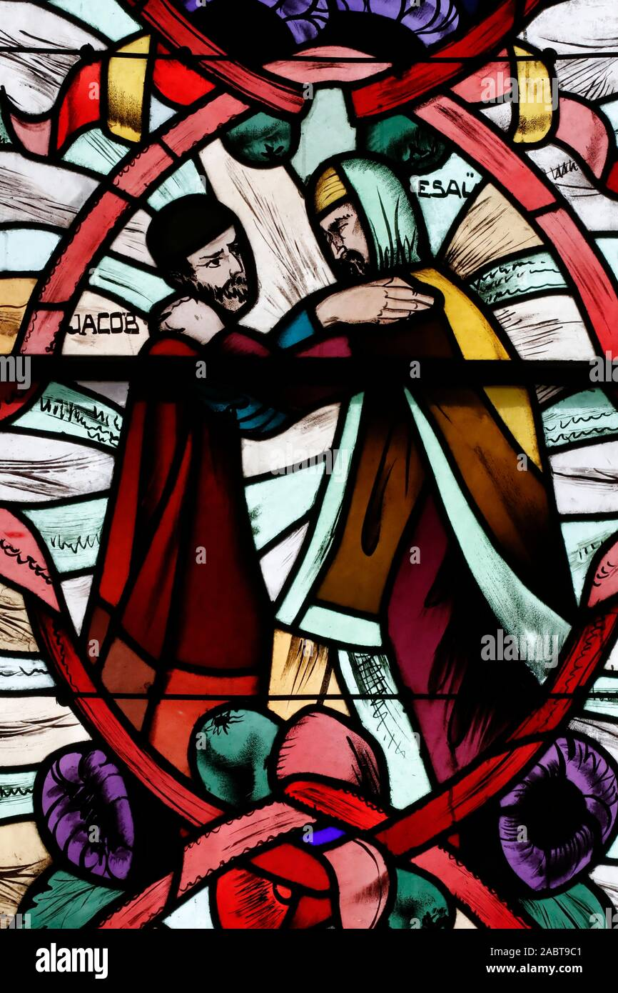 Saint Joseph des Fins church. Jacob and Esau. Stained glass window.  Annecy. France. Stock Photo