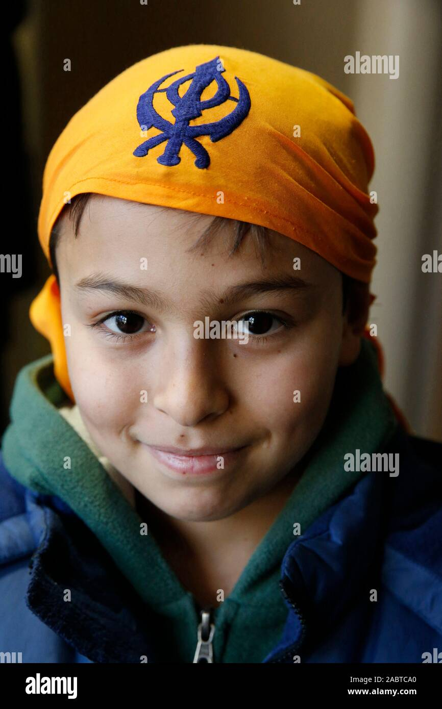 11-year-old boy in a sikh temple in Bobigny, France. Stock Photo