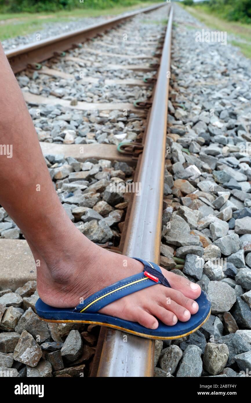 Foot on railway track.  Kep. Cambodia. Stock Photo