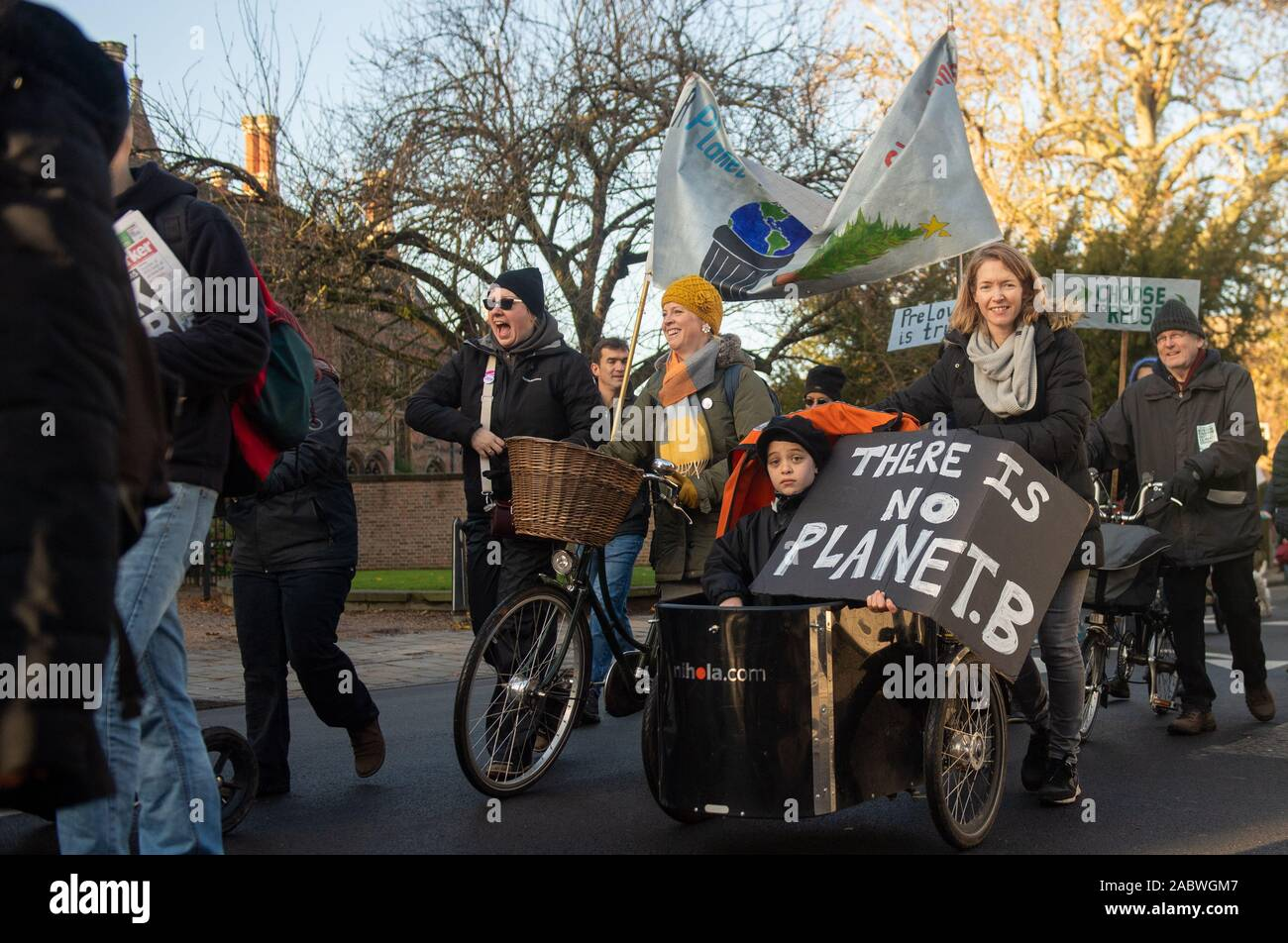 People take part in the YouthStrike4Climate march in Cambridge. Stock Photo