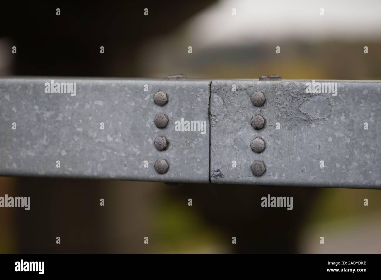Closeup bolt caps on steel structure Stock Photo