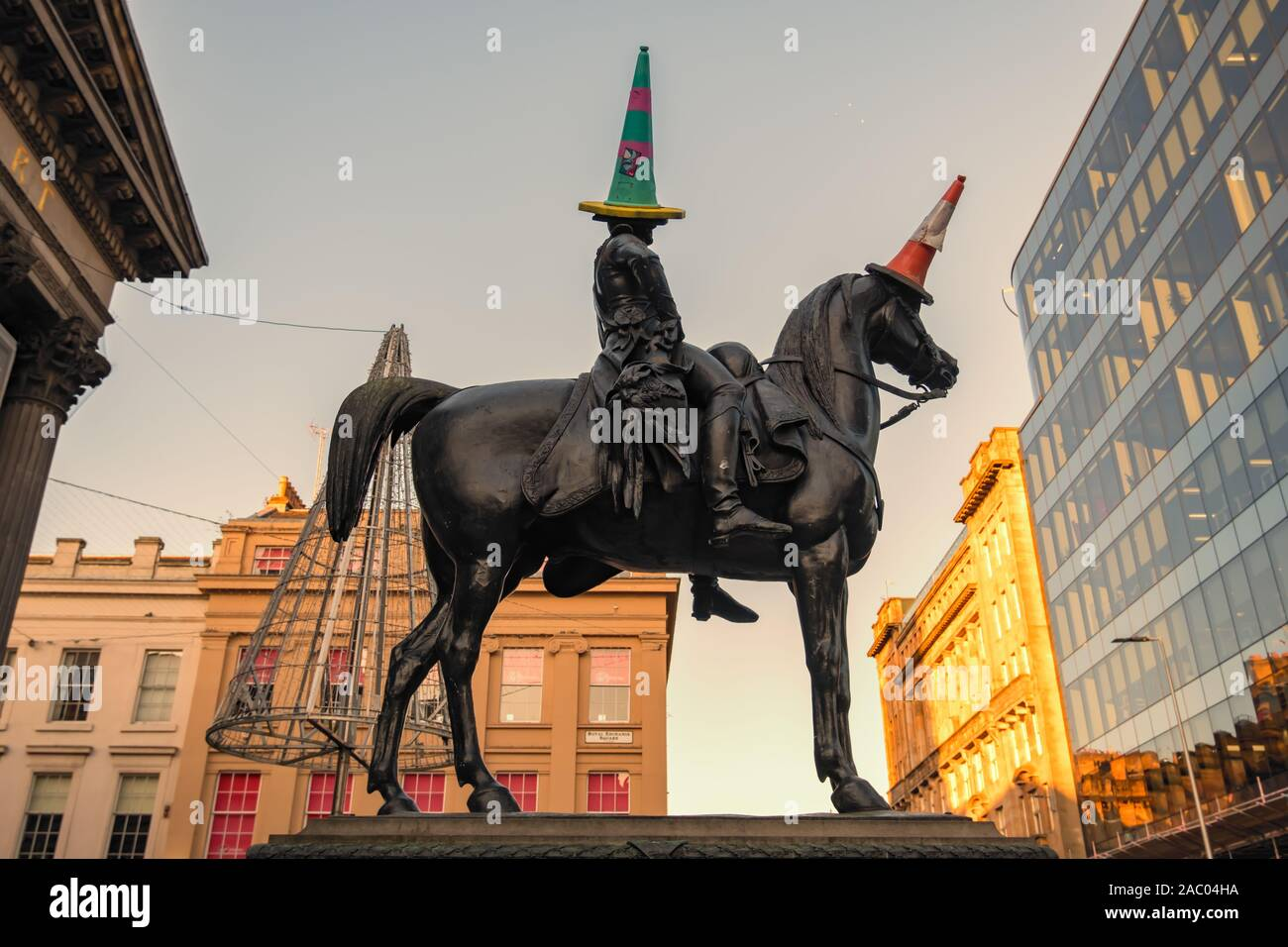 Glasgow, Scotland, UK. 29th Nov, 2019. UK Weather. The statue of the Duke Of Wellington with a green and red traffic cone on the duke's head and a red and white traffic cone on the head of the war horse Copenhagen. Credit: Skully/Alamy Live News Stock Photo
