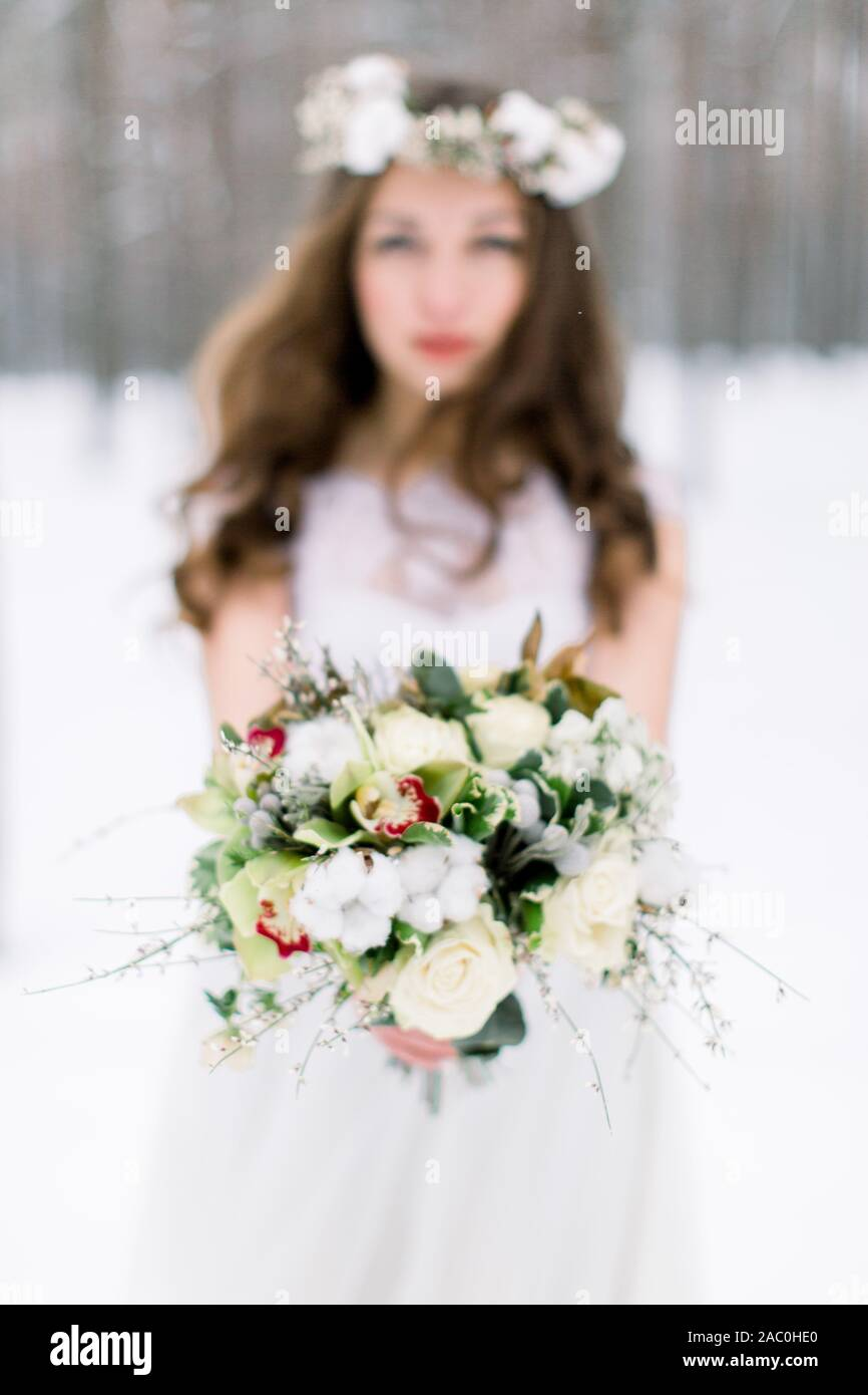 Winter Wedding Flower Bouquet With Cotton Young And Beautiful Bride With The Flower Bouquet In Winter Forest Focus On The Bouquet Stock Photo Alamy