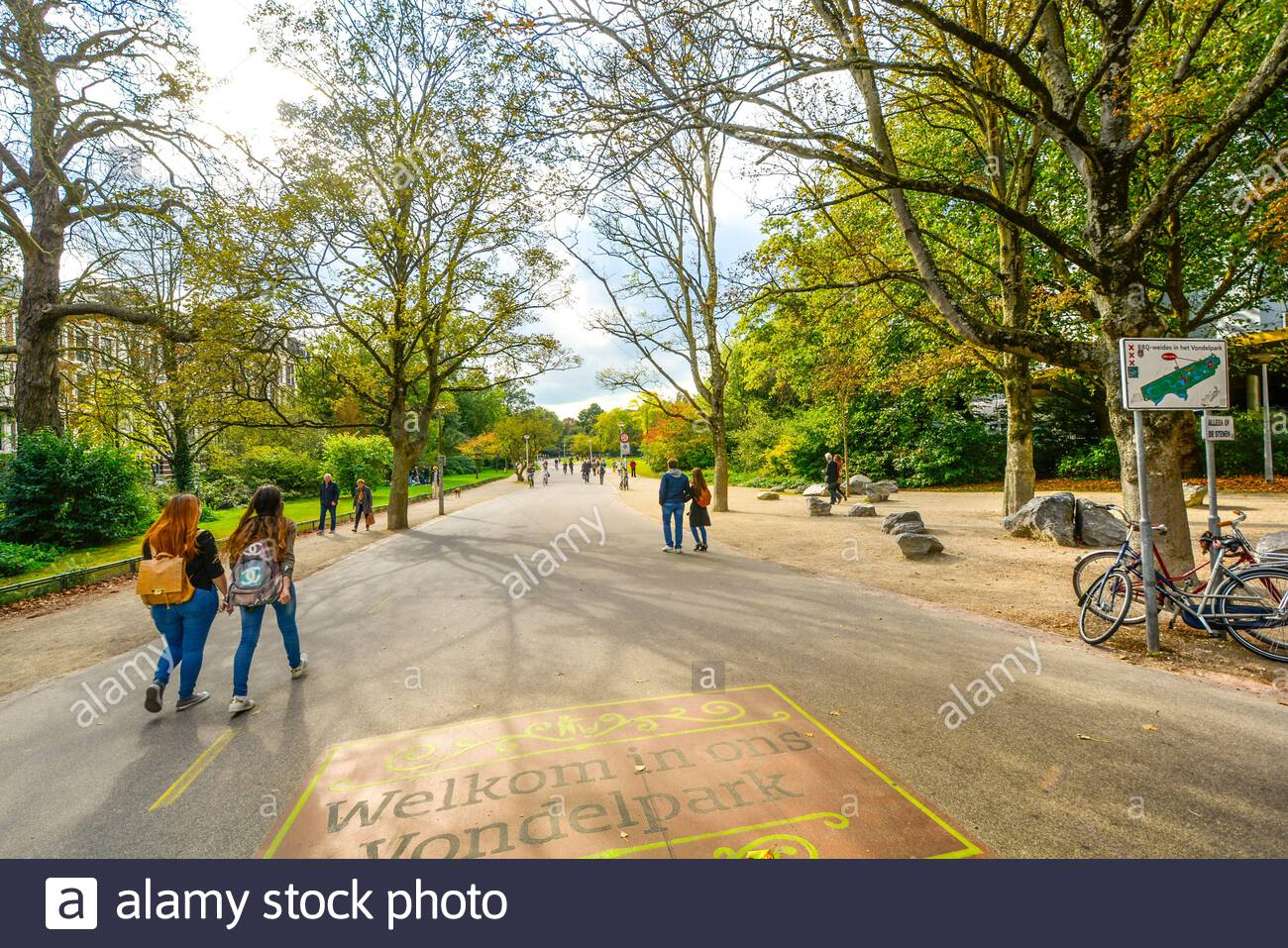 Tourists and locals enjoy an afternoon at Vondelpark, the large city park in the museum district of Amsterdam, Netherlands in early autumn. Stock Photo