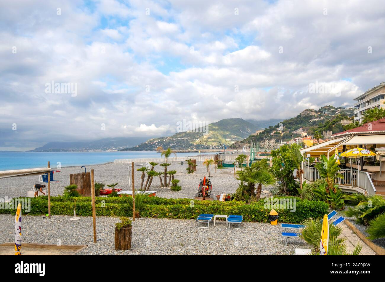 Morning along the resort coast of the Italian Riviera looking towards France at the city of Ventimiglia, Italy. Stock Photo