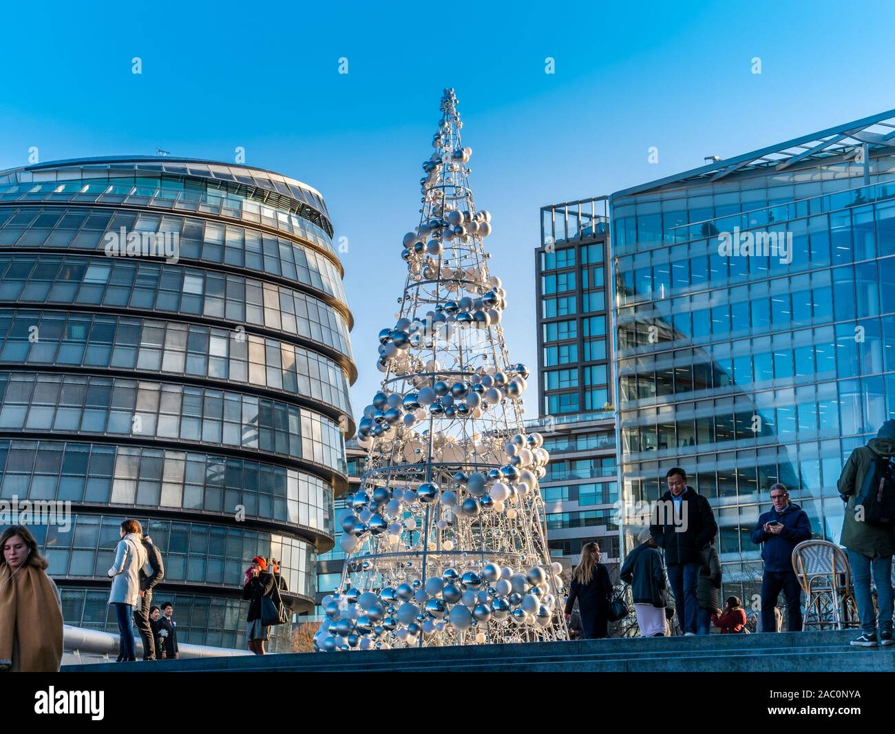 London, England, UK - November 29, 2019: Christmas tree decorated outdoors in a day time for winter holiday celebration in a beautiful town square of Stock Photo