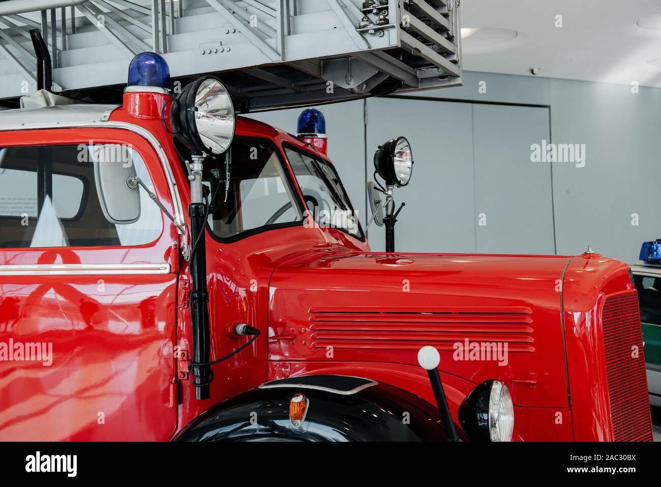 Side view. Front of the red polished fire truck standing indoor at exhibition Stock Photo